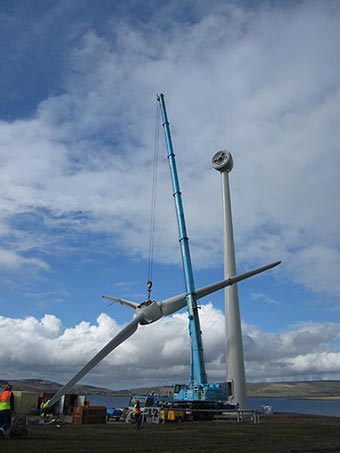 Phot of Rennibister Wind Turbine rotor being craned into position
